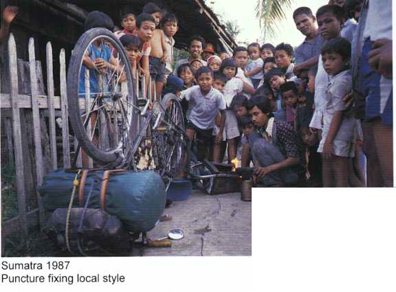 Sumatra 1987 - Fixing a puncture local style